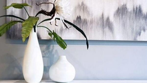 Contemporary home décor and accents display: vases by Torre & Tagus, and painting by Leftbank Art